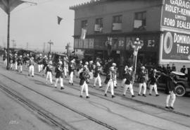 [Band marching in parade on Columbia Street]