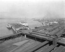 [View of the harbour, C.P.R. Pier 'D' and railroad yard from the roof of the Post Office]