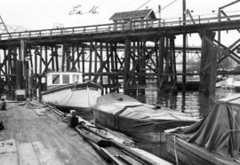 [Boats at dock beside the C.P.R. Kitsilano trestle bridge]