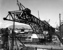 The unsupported channel span four panels beyond the centre [construction of steel deck truss over...