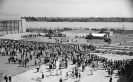 [View of crowds at the launch of the first patrol bomber from the Boeing plant on Sea Island