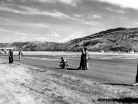 [Film crew on runway preparing to film water bombers at Kamloops Airport]