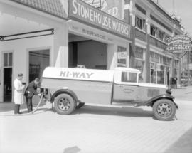[Hi-Way] Oil truck [making delivery to] Stonehouse Motors Limited [at 418 West Georgia Street]