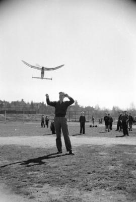 [Man with plane at model aircraft meet]