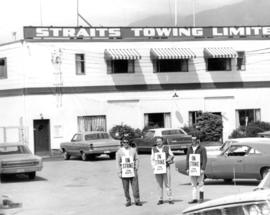 Three tow boat operators on strike in front of Straits Towing Limited