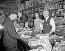 [Man from Kelly Douglas Ltd. taking an order for supplies at a grocery store]