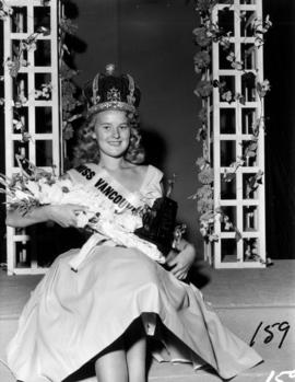 Winner of Miss Vancouver 1955 posing with flowers and crown