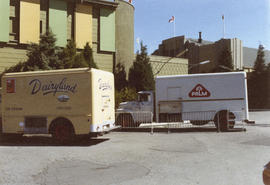 Dairyland and Palm trucks outside of Food building