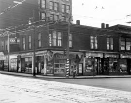 [Exterior of businesses on the south west corner of Pender and Richards Street]