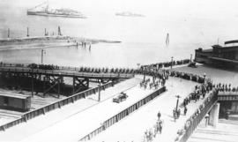British fleet [sailors marching onto dock]
