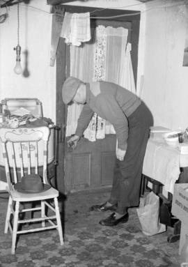[Unidentified man in a laundry and utility room]
