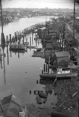 [Coal sheds, boat sheds and wharves in False Creek at the foot of Quebec Street]