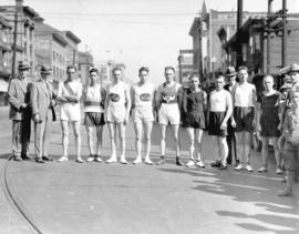 [Mayor L.D. Taylor with athletes on East Hastings Street near Main Street]
