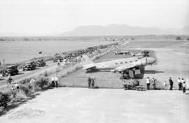 [View of crowds and a U.S. Mail Express (NC 1338 Boeing) airplane at airshow]