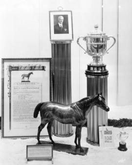[Trophies and other items associated with the Robert F. Leighton Memorial horse race and The Bree...