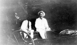 [L.D. Taylor and Barlow in horse and buggy in Manila]
