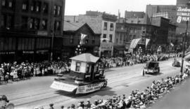 "[The ""Neverot"" Stained Shingles float in the Dominion Day Parade]"