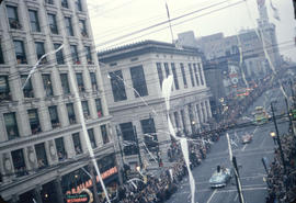 43rd Grey Cup Parade, on Granville Street at West Pender, cars, ticker tape, spectators and Vanco...