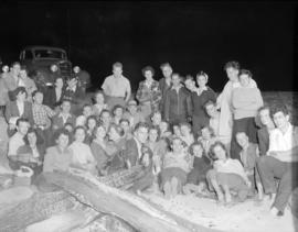 [Group of B.C. Telephone employees at a social event on the beach]