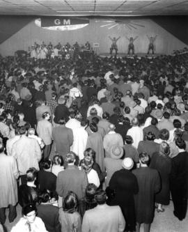 Crowd at stage performance in Pacific Showmart building