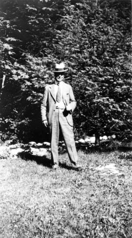 [L.D. Taylor standing in front of trees]