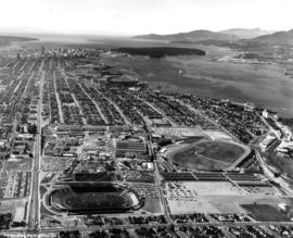Aerial photograph of P.N.E. grounds and surrounding area looking northwest, including Burrard Inl...