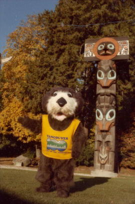 Tillicum in front of totem poles at Brockton Point