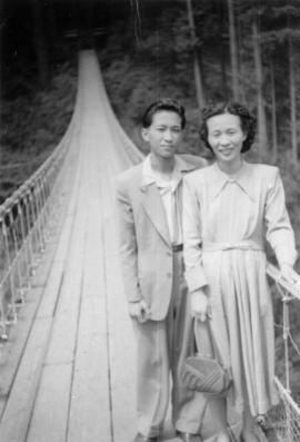 Mrs. Chan and one of her sons on a pedestrian bridge