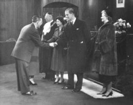 [Alderman Archie F. Proctor greets H.R.H. Philip Duke of Edinburgh and H.R.H. Princess Elizabeth]
