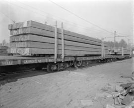 [Rail freight cars carrying Timberland Lumber Company Ltd. lumber]