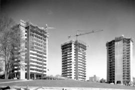 [Three West End apartment buildings in construction phase]