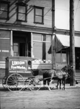 [Storefront and delivery wagon of Union Dye Works]