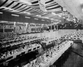 Tables, chairs, and place settings prepared for event in Pacific Showmart building