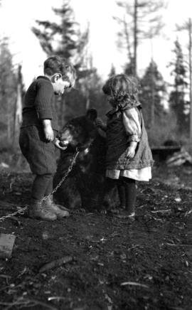 [Kenelm and Theresa Quiney with bear cub.]
