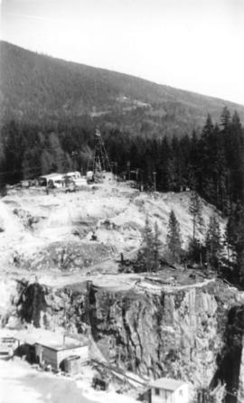 Looking east.  Upper canyon on Capilano River.  Buildings are contractors for Cleveland Dam