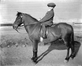 E.R. Rickett's nephew [with horse at Horse Show]