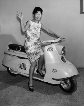 Catherine Arakawa on scooter in Japan's Salute to the Orient exhibit at the 1959 P.N.E.