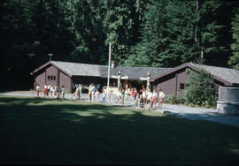 Group learning archery in front of Camp Capilano building