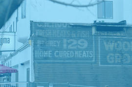 [Signs for C.H. Moodie Fresh Meats and Fish and Woolner's Grocery uncovered on the east side...