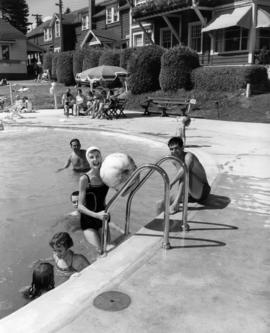 [Swimmers at poolside at Bowen Island Inn]