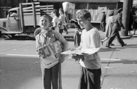 [Boys selling newspapers during VJ Day celebrations]