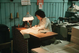 Seamstress working at Wing Hing Dry Goods
