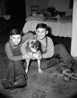 [Portrait of two boys with a dog]