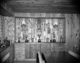 [Trophy and ribbon cabinet at Fairmead Farm]