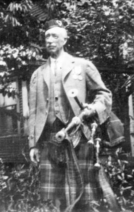 [Hector Mackenzie with his bagpipes]