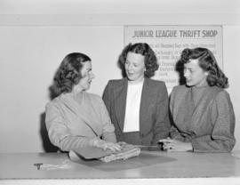 [Women wrapping an item at the Junior League Thrift Shop]