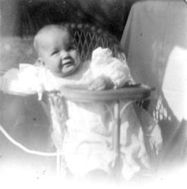 [Theodore Taylor sitting in high chair at age 13 months]