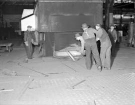 [Men at work at Western Bridge and Steel Fabricators Ltd.]