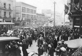[Armistice day procession on Granville Street at Georgia Street]