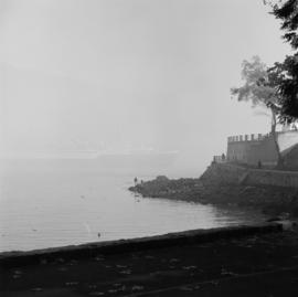 Ghost ferry [ferry pasing through fog with Sea Wall in the foreground]